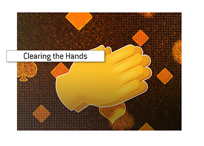 What does the act of clapping hands mean if you are dealer at a casino.