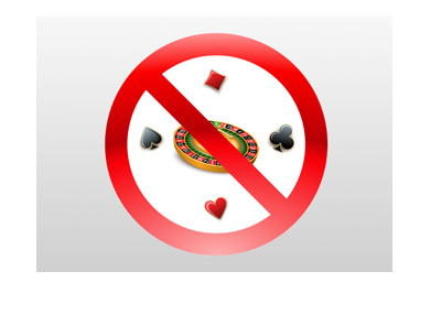 Online gambling ban - Illustration - Roulette wheel and card symbols with a red NO sign on top.